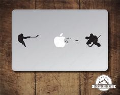 Hockey Player Blasting the Apple vs Goalie Macbook by DenverDecals