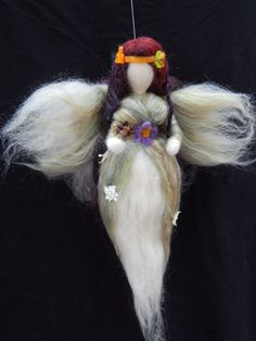 Wool fairy waldorf inspired  http://underthemulberrytree.squarespace.com/suzannes-craft-journal/2013/11/18/autumn-fairy.html