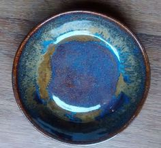 amaco 5/6 3 coats of Blue Rutile and 3 coats of Ancient Jasper on the rim and a bit down from the rim.
