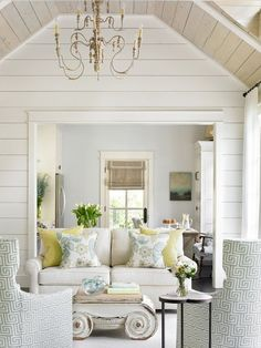 what  a pretty home! love the wall treatment and the light, airy feel.