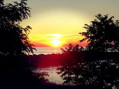 Faux tropical sunset over lake Erie