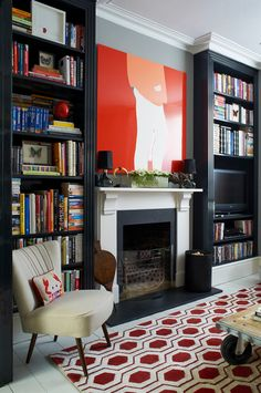 A bold London home - desire to inspire - desiretoinspire.net - Turner Pocock - fireplace + bookcases