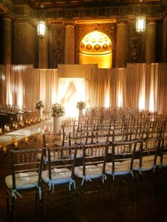 Ivory wedding. Ivory drape with antique white and amber lighting. HJ Planners, Edge Flowers, Fabrications, Digital Lightning and Party Rentals.