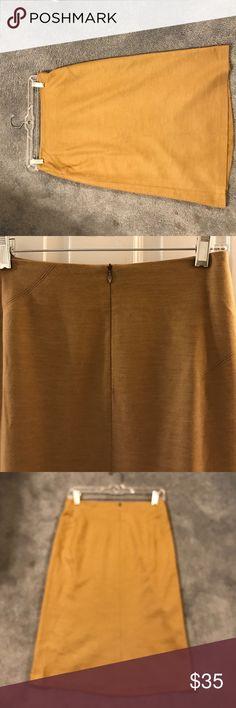 BCBG woman's skirt BCBG Woman's skirt . Size 4,skirt is lined. 70%Acrylic, 30% Wool.Skirt gently worn. Back zipper closure. Skirt is knee length. BCBGMaxAzria Skirts Midi
