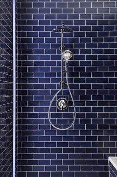 Wow! The blue subway tile in this #bathroom shower stall is great! remodelworks.com http://remodelworks.com?utm_content=buffer3a58d&utm_medium=social&utm_source=pinterest.com&utm_campaign=buffer