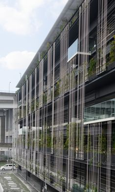 Here we have undertaken a green wall project for a newly opened multi-storey car park in the coastal area of Nagoya, which has seen an increase in. Office Building Architecture, Green Architecture, Building Facade, Residential Architecture, Architecture Details, Building Skin, Mix Use Building, Parking Building, Parking Lot