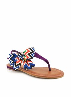 Tribal printed bow t-strap sandals.