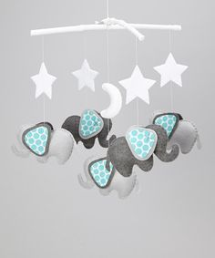 Decorate a sweetie's crib with the soothing felt appliqués on this mobile. Designed with happy animal pals to keep Baby company while sleeping, it also features space-bound characters that'll have them reaching for the stars.Approx. 12'' W x 14'' HHanger: woodDecoration: felt / polyfill