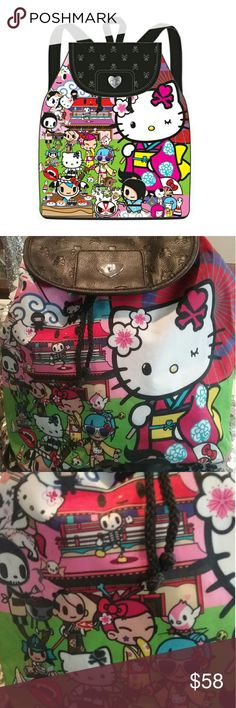 Tokidoki for Hello KITTY BACKPACK Hello kitty in her traditional Kimono hanging out with her Tokidoki Pals .This mediun backpack is nylon easy to clean back faux leather looking.  Snap top with tokidokio logo, a Senrio product. Hello Kitty Bags Backpacks