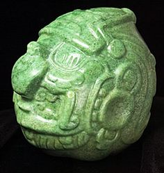 This is an ancient mayan carving in jadeite jade of the Sun God. It is the largest jade carving of its kind and it is over a thousand years old.