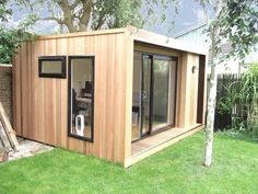 Edge garden office with sliding patio doors and feature picture window in graphite grey, from plus VAT Container Home Designs, Backyard Studio, Garden Studio, Outdoor Office, Cool Office Space, Outside Room, Prefabricated Houses, Sliding Patio Doors, Garden Office