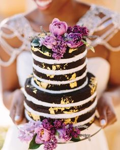 Something different - a chocolate naked cake - beautifully decorated with purple blooms ~ Munaluchi Bridal Magazine