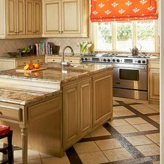 Note a few things in common.  Stove under window; small tiled backspash, really classy shade.   Cabs in earth tones
