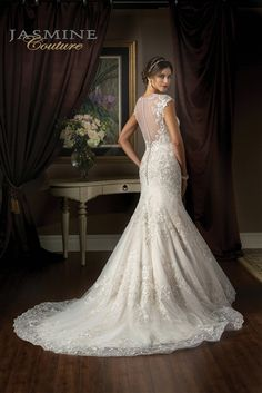 Beautiful Fit and Flare Wedding Dress <3 2015 Embroidered Lace on Tulle Over Satin Fit & Flare Mermaid Gown with an Illusion Neckline Over Sweetheart, Cap Sleeves, Lace on Tulle Fitted Bodice Past Hips, Scattered Lace Fit & Flare Mermaid Skirt with Scalloped Lace Hemline, Chapel Train, Illusion High Back Over Low Back with Covered Buttons. #sheerback #laceback #laceweddingdress #mermaidweddingdresses #customweddingdress #sheerback #beautifulweddingdress #2015weddingdress #sayyesto…