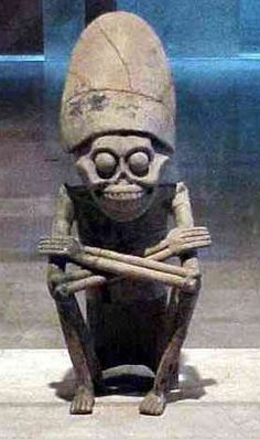 Statuette of Mictlantecuhtli in the Museo de Antropología in Xalapa, Mexico, 2001.  CUte little lord of the underworld.  Looks a bit like an alien. Fear him!