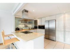 A contemporary and fully modern open-plan kitchen. Bespoke kitchen with breakfast bar including an integrated Miele Espresso machine: Double fridge/freezer.   See more at: www.remax-signature.co.uk
