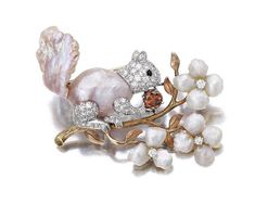 A cultured freshwater pearl, diamond and colored diamond brooch, Ruser