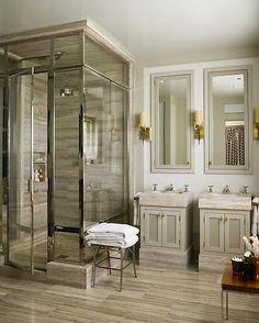 sleek bathroom with striated wood look tile floors glass polished shower enclosure
