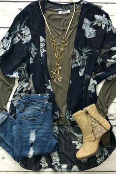 Our 'What To Say' Kimono is such a rich color! We are loving the navy with the bold floral print! This kimono is perfect for layering and styling for F A L L! ​True to size, floral print throughout, made to be loose fitted.