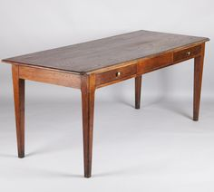 "French Country Table/Desk <p>Originally a Farm Kitchen Table, this piece from the Beaujolais Region has the perfect size to be used as a desk. Made of oak with tapered legs, the top has rounded edges on the front and the two drawers have brass pulls.  Floor to apron measures 25.5"".</p>"