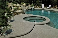 Gorgeous Washington Natural Exposed Aggregate Deck - Spa + Pool - New England. #triad #dreampool http://on.fb.me/1gt4Ta2