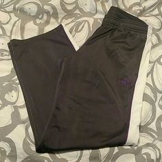 """Puma track suit EUC Puma track outfit. Grey with purple piping along a white stripe. Striping goes down arms and legs of pants. Jacket is a small. Pants are a medium. Pant inseam is 32"""". Puma Other"""