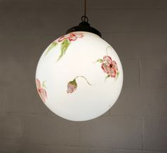 Family Friday! This floral globe was hand painted by one of our family/team members. We created five of these for @punchbowlsocial.  #familyowned #familybusiness #handpainted #familymade #creativelighting #florallighting #floral #customlighting #customlightfixtures #customlightingdesign #lightingdesign #customdesign #lightfixtures #hospitalityindustry #hotellighting #restaurantlighting #wallsconce #chandelier #pendant #accentlighting #moodlighting #manufacturing