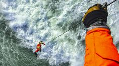 USCG, Rescue Swimmer and Flight Mechanic perform high seas hoisting during Advanced Helicopter rescue school.