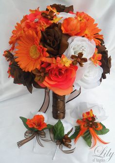 Bouquets of flowers have always been one attraction at any wedding. Bouquets are already part of the wedding tradition on all races. A bouquet of flowers symbolizes a blossoming maiden and reflects her emotions.Therefore, wedding bouquets should be. Silk Flower Bouquets, Silk Flowers, Wedding Bouquets, Bridesmaid Bouquets, Orange Wedding, Wedding Colors, Camo Wedding Flowers, Camo Wedding Decorations, Rustic Wedding