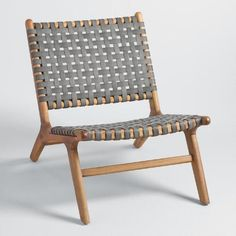 Solid acacia wood paired with flat woven weather-resistant wicker straps in charcoal gray creates visual contrast and contemporary appeal. These versatile seats feature a low profile, wide seat and pitched back for enhanced comfort.