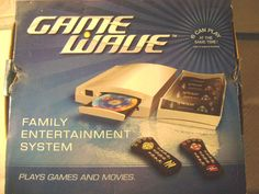 GAME WAVE-(FAMILY ENTERTAINMENT SYSTEM)PLAYS GAMES AND MOVIES-4 REMOTES *