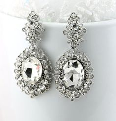 "Bridal Earrings Wedding Earrings Wedding by goddessdesignsgems, $49.00 ""Red Carpet Fabulous"" ""Victorian Inspired"" earrings featuring a stunning filigree design surrounded with Austrian crystals with a large sparkling stone drop encrusted with brilliant clear crystals. If you are looking get noticed, these earrings will deliver, they are absolutely gorgeous!"