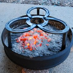 CAMPING grate Stand with Grill Dutch Oven I could probably DIY, love the use of horse shoes!