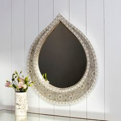 teardrop shaped mother of pearl mirror