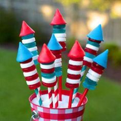 "A patriotic candy explosion:"" Just fill drinking straws with Pop Rocks, stack patriotic-colored Life Savers and add some cone-shaped Airhead candies on top. KABOOM! A clever treat that's fun and sweet to eat."""
