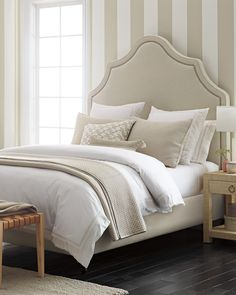 This airy bedroom feels elegant with a curvy headboard, striped walls, and a raffia nightstand. Brown Bed Linen, Neutral Bed Linen, Luxury Duvet Covers, Luxury Bedding Sets, Magazine Design, Beige Headboard, Airy Bedroom, Master Bedroom, Master Suite