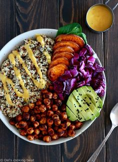 Curry Chickpea Sweet Potato Buddha Bowl. Healthy, nourishing and protein-packed, this vegan buddha bowl has it all: fluffy quinoa, crispy spiced chickpeas, mixed greens, and a curry dressing!