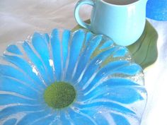 Small blue and green floral dish. Fused glass, ruffled edges - 7 wide -1.5 high. Perfect condition.