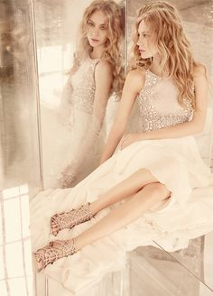 <p>Ellie</p>Ivory chiffon A-line bridal gown, blue alabaster-encrusted bodice with bateau neckline, open back accented with beaded straps, full chiffon circular skirt. Bridal Gowns, Wedding Dresses by Hayley Paige Bridal - JLM Couture - Bridal Style HP6551 by JLM Couture, Inc.