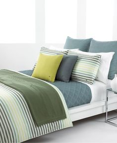 Stripes and lattice pattern give this Lacoste bedding depth and interest. Love the fun green throw.