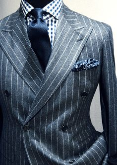 Double Brested, grey pinstripe suit, blue tie/pocket square, blue gingham check shirt.