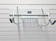 The Garageflex Horizontal Bike Rack is perfect for storing your bike on the garage wall.  Here is the rack without anything added, it is easy to use and keeps bikes out of the way.  Holds one bike and accessories such as helmets, shoes etc.