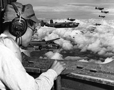 From the radio operators position in a USMC PBJ Mitchell Japanese POW 2Lt Minoru Wada looks for landmarks to find the Japanese 100th Infantry Division headquarters complex 9 August 1945 Mindanao Philippines.