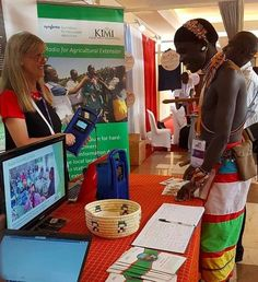 Kristine demonstrating a Lifeplayer to a Samburu moran (warrior) at the Social Behaviour Change Conference in Nairobi today. Solar Energy, Solar Power, Behaviour Change, Agricultural Extension, Clean Technology, Education For All, Social Behavior, Knowledge Is Power, Nairobi