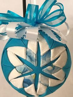 Turquoise and white cotton fabric used. Handmade no sew quilted ornament Decorative ribbon added with a ribbon hanger. Folded cotton fabric squares pinned on a 3 polystyrene ball. No sew. All of my items come from a smoke/pet free home. Metal hanger not included. I will