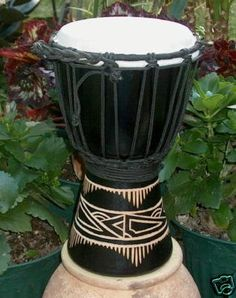 """Black Line Carved Djembe-11""""-12"""" Tall x 7""""-8"""" Head by Mother Rhythm Drums. $35.00. Black line carved design djembe drum. Made of one-piece mahogany, and typically measures anywhere between 11-12 inches tall, with overall diameters of approximately 7 inches, and playing surface diameters of approximately 6 inches. Goat skin from the back of the goat - the thickest portion is used. Snappy sound on these little guys and perfect for kids or an excellent light weight tr..."""