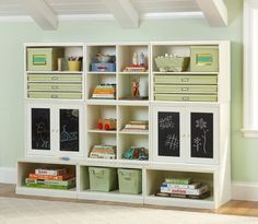 KIDS STORAGE: This is a great idea for any size room. It creates the perfect space for storage and activities. Hmmm! I think I will combine the two book shelves in my son's room to create my own kids storage area.