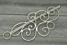 Metal Hair Barrette - Pretty, though it would never work in my hair... $24.00
