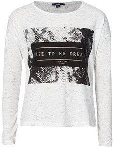 Slogan print T-shirt Girls age 10 to 18 years 10,00EUR Long sleeve t-shirt Fancy dual fabric T-shirt. - Jersey T-shirt - Long sleeves - Round neck - Faux suede detail