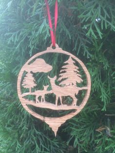 A personal favorite from my Etsy shop https://www.etsy.com/listing/487912189/fretwork-deer-christmas-tree-ornament